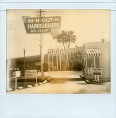 In-N-Out Drive-Thru 4 (tobysx70) Tags: the impossible project tip pz600 uv bw blackandwhite sepia expired film polaroid image spectra system 1200 camera impossaroid innout hamburgers drivethru francisquito avenue baldwin park california ca replica 1948 original store neon sign crossed palm trees red yellow arrow logo 2way speaker awning no delay fast food restaurant burger french fries shakes doubledouble animal style thatswhatahamburgersallabout beautiful decay toby hancock photography