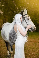 Sensual and Sexy Caucasian Blond Female with Long White Hair Standing with Horse Against Bright Light on The Background. (DmitryMorgan) Tags: 1 horse brown cute field grass animal female fun happy freedom dress farm country activity breed equestrian active bridle caucasian ranch light love nature outside outdoors person meadow lifestyle pony romantic leisure recreation lovely joyful horseback summer vacation woman sun smile spring young sunny stud trot salution