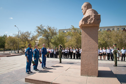 The backup crewmembers for the next launch to the space station at a statue of Sergei Korolev