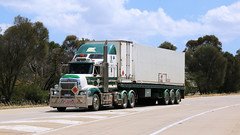 Rest Triple (2 of 3) (Jungle Jack Movements (ferroequinologist) all righ) Tags: rustys own kenworth 1984 w925 explosives kalgoorlie boulder sarge sarges freightliner argosy hp horsepower big rig haul freight cabover trucker drive carry delivery bulk lorry hgv wagon road nose tri quad double axle semi trailer deliver cargo interstate articulated vehicle load freighter ship move motor engine power teamster truck tractor prime mover diesel injected driver cab wheel b manton rest hume highway melbourne sydney transport coolalie