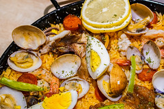 Baked shells with eggs and shrimp on fried rice (wuestenigel) Tags: toppings paella roastedchicken stockphotography roastedpig digitalnomad bits tasteful bacon mixedseafood tasty food closeup foodphotography egg rice reiseblogger spices peppers seafood hardboiled yummy delicious shells 2019 2020 2021 2022 2023 2024 2025 2026 2027