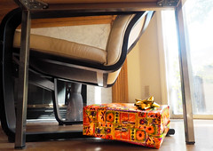 The Present (LeftCoastKenny) Tags: utata ironphotographer utata:description=hide utata:project=ip289 table chair floor box wrappingpaper repeating pattern intensecolor
