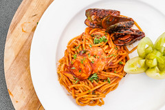 Flat lay shot of seafood spaghetti dish (wuestenigel) Tags: detailshot stockphotography tomato himamaylan digitalnomad culinary tasteful localdish tasty masterpiece greenshell delicious closeup foodphotography delicacies plating reiseblogger spaghetti design shrimp localfood yummy dish food 2019 2020 2021 2022 2023 2024 2025 2026 2027
