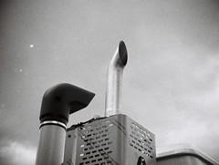 Exhaust pipe (Matthew Paul Argall) Tags: jcpenneyelectronicstrobepocketcamera fixedfocus 110 110film subminiaturefilm lomographyfilm 100isofilm blackandwhite blackandwhitefilm exhaustpipe exhauststack truck