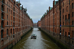 Hamburg - Speicherstadt (cnmark) Tags: architecture buildings germany deutschland boat hamburg sightseeing architektur kanal fleet speicherstadt channel warehouses ausflugsboot red brick rot gebäude ziegel ©allrightsreserved bettinaehlers canal