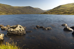 Calming Waters (steve_whitmarsh (touring 3 weeks in India)) Tags: landscape aberdeenshire scotland scottishhighlands mountain hills highlands water loch lochcallater lake longexposure rock rocks cairngorms topic abigfave