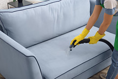 Woman cleaning couch with vacuum cleaner at home (acepestcontrol) Tags: apartment house color home comfortable female person design hands furniture contemporary background interior room machine cleanup dirty professional clean couch equipment company indoors dirt sofa housework domestic remove maintenance glove service material cleaner decor electrical household hygiene chores housekeeping nozzle cleanliness woman stain work vacuum surface steam upholstery