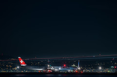swiss air holds for departure with united (pbo31) Tags: bayarea california sanmateocounty night dark black nikon d810 color september 2019 boury pbo31 sanfranciscointernational sfo burlingame aviation airline runway plane flight departure airport travel lightstream motion traffic taxi swissair boeing 777 united red
