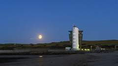 Moon Tower (syf22) Tags: aberdeen harbour moon satellite round ball global moonrise blue bluehour control tower building structure aberdeenshippingcontrolcentre lookout direction sand beach seaside beachfront eve evening dayends endofday bright pier barrier shelter rock
