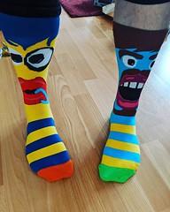 Birthday feet covered in birthday socks.
