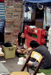 Protester on a Break (cowyeow) Tags: protest occupy hongkongprotests hongkongprotest occupyhongkong occupycentral politics political umbrellamovement democracy dissent student students news street city central hongkong china chinese asia asian 香港 admiralty girl young pretty cute beautiful mess messy candid