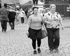Couple in Bolton (Tony Worrall) Tags: street streetphotography urban candid people person capture outside outdoors caught photo shoot shot picture captured picturesinthestreet photosofthestreet bolton couple partners walk female women nw northwest north update place location uk england visit area attraction open stream tour country item greatbritain britain english british gb buy stock sell sale ilobsterit instragram