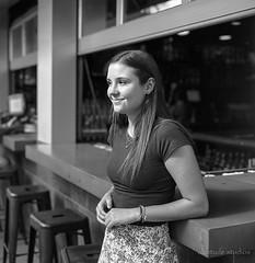 Waitress at the counter (altotude studios) Tags: bronica sqa ilford delta100 bw monochrome film streetphotography mediumformat zenzanon pretty girl