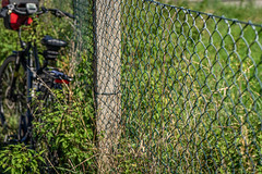 2019 Bike 180: Day 132, September 13 (suzanne~) Tags: 2019bike180 bike fence fencedfriday
