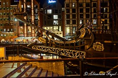 Pirate Ship Bow, Gdańsk, Poland (elzbietafazel) Tags: city travel sky detail night river movie boat carved mood ship cityscape waterfront decorative pirates postcard sightseeing poland scene bynight illuminated adventure replica romantic caribbean gdansk touristattraction mock galleon sailingboat touristdestination czarnaperla
