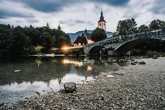 . (halagabor) Tags: bridge mountain lake mountains alps reflection church nature water landscape mirror nikon julia landmark slovenia bohinj outlandish naturelove d610 longexpo clouds