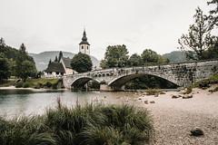 . (halagabor) Tags: slovenia alps julia bohinj lake water reflection mirror landscape landmark outlandish nature naturelove nikon d610 longexpo mountains mountain church bridge