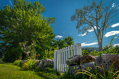 Smallest Fence Friday ever (FotoFloridian) Tags: wall fencefriday fence grass outdoors nature sky blue nopeople old summer greencolor landscape stonematerial scenics architecture day ruralscene sony alpha a6400 rokinon12mm