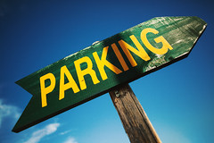 Closeup of Parking Arrow (dejankrsmanovic) Tags: wood old blue sky green sign vintage way wooden colorful place traffic handmade object painted text parking pillar vivid location structure retro direction letter weathered arrow aged solution textual stilllife abstract yellow rural table design paint board concept copyspace conceptual simple crafted nonurban