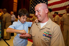 Chief Yeoman David O'Leary is pinned to the rank of chief petty officer by his son.