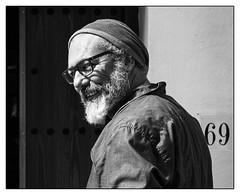 L'artiste de l'année. (francis_bellin) Tags: portrait espagne streetphoto street bwphoto netb photoderue volets ombre olympus barbe lunettes village homme bw blackandwhitephoto monochrome rue noiretblanc blackandwhite sourire blanco 2019 andalousie frigiliana