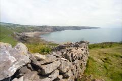 Overlooking The Bay (Bas Tempelman) Tags: gower peninsula wales united kingdom shore sea rocks stones cliffs bristol channel kodak portra 160 nikon f801s coast port eynon strand beach wall