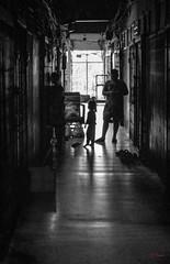 Daily Life in Chinatown (grab a pic) Tags: canoneos5dmarkiv canon eos 5d bangkok bangkokmetropolitanregion thailand 2019 yaowaratroad chinatown streetphotography people portrait indoor boy girl bw blackandwhite grain
