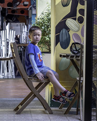 Curious Boy (kristenscotti) Tags: street boy candid child children color happy microfourthirds olympus pen penf people social streetlife streetlight streetphotography streetportrait streetshooter streetshot streetvision zoom zuiko singapore centralregion person haji lane road chair bench table ladybug mural sandals durian shorts portrait jeans blue wood fence selfiecafe