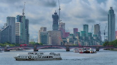 Thames.... (Photo_hobbyist) Tags: cityscape london buildings bridge city boat skyscrapers water river thames clouds