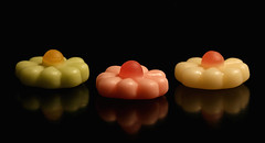 flower sweets (HansHolt) Tags: gums sweets confection flower yoghurt yogurt pink green white tabletop mirror reflection black macro canon 6d 100mm canoneos6d canonef100mmf28macrousm smileonsaturday reflectiononblack