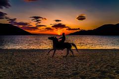 Sunset riders (Vagelis Pikoulas) Tags: sun sunset silhuette canon 6d porto germeno greece beach sea seascape landscape nature 2019 september autumn