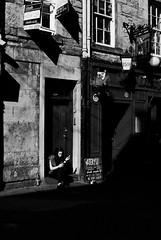 (Devin Walker) Tags: nikon d200 edinburgh street urban bw monochrome tamron adaptall 02b woman step smoking doorway