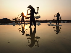Salt farmer at work (Rama Nusjirwan) Tags: humaninterest sunrise indonesia reflection