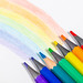 Rainbow and pencils of rainbow colors on white background