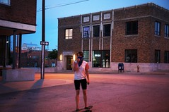 To Whom? The Streets, The Night, The Motion... (sidewinder_7777) Tags: neon bride skateboard kansascity architecture dusk streetscape city terracotta motionblur bandana