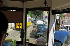 The challenges of driving a streetcar - Lisbon, Portugal (TravelsWithDan) Tags: streetcar driver transportation urban city cars crowded chaotic oldtown lisbon portugal europe candid canong3x throughtheglass
