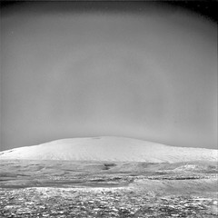 Mount Sharp, variant (sjrankin) Tags: 14september2019 edited nasa mars msl curiosity galecrater navcam grayscale nrb621482465edrf0763002ncam00556m rocks sand dust mountain mountsharp sky haze