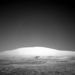Mount Sharp (sjrankin) Tags: 14september2019 edited nasa mars msl curiosity galecrater navcam grayscale nrb621482465edrf0763002ncam00556m rocks sand dust mountain mountsharp sky haze