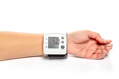 Blood pressure and pulse tonometer on the patient's wrist (wuestenigel) Tags: monitor high pulse measurement medicine diagnosis hand background diagnostic healthy man instrument check cardiology care blood equipment pressure health heart test medical examination checkup 2019 2020 2021 2022 2023 2024 2025 2026 2027