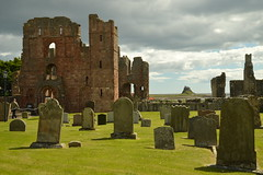 Gravestones and the Priory of Lindisfarne (CoasterMadMatt) Tags: lindisfarnepriory2019 lindisfarnepriory lindisfarneprioryruins ruin ruins ruinedmonastery monastery monasteries northumberlandmonasteries monasteriesinnorthumberland englishmonasteries monasteriesinengland westfront west front lindisfarne2019 holyislandoflindisfarne2019 holyisland2019 holyislandoflindisfarne holyisland holy island lindisfarne tidalisland village villages englishvillages stmarythevirgin saintmarythevirgin st saint mary virgin stmaryschurch saintmaryschurch church churches englishchurches churchesinengland northeastengland northeast england britain greatbritain gb unitedkingdom uk europe building structure architecture englishhistory english history historicalbuildings northumberlandattractions attractionsinnorthumberland attraction attractions june2019 summer2019 june summer 2019 coastermadmattphotography coastermadmatt photos photographs photography nikond3200