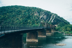 Maryland Heights From Below (J. Parker Natural Florida Photographer) Tags: appalachia harpersferry potomac potomacriver westvirginia forest hike hiking historic history woods maryland cliff rock mountain peak railroad ridge train bridge crossing appalachiantrail marylandheights rockface river old valley