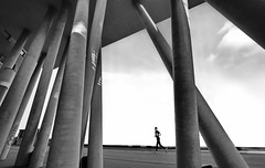 the runner (heinzkren) Tags: wien vienna zahahadid schwarzweis blackandwhite monochrome biancoetnero noiretblanc sport running mann man human geometry outdoor säulen abstract sky clouds street streetphotography pillars