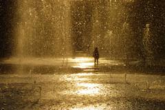 Water games (Mango982) Tags: water fontana fountain acqua shilouette shadow children bambino reggio sunset tramonto oradoro oro giallo yellow alone solo solitudine solitude city backlight controluce