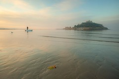 Rowing to the yacht (Julian Barker) Tags: st michaels mount marazion cornwall bay sea shore seashore coast reflections rowing boat rower man sunrise subtle cloud julian barker canon dslr 5d mkii