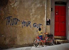Cagliari-Trust your gut (Ivan Dessi) Tags: cagliari cagliarigraffiti city calle art fujifilm fujilmx10 fuji graffiti life x10 casteddu mural murales muro muralpainting street streetart sardegna spray strada