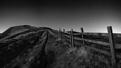 Back to the Gate (FadeToBlackLP) Tags: mamtor peak district moonlight moonlit fence vanishing point stars night sky nightsky leadingline mono landscape longexposure stacked sequator