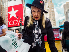 The New Yorkers - Around Macy's (François Escriva) Tags: street streetphotography us usa nyc ny new york people candid olympus omd photo rue sun light woman colors sidewalk manhattan poster macys herald square red star blue sky clouds style