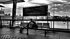 Waiting For The Train. (ManOfYorkshire) Tags: blackfriars station railway train platform reading newspaper waiting london england gb uk bw blackwhite city