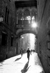 Carrer del Bisbe (Douguerreotype) Tags: people monochrome bridge light barcelona blackandwhite shadow catalunya buildings street spain mono sunrise architecture arch city urban bw