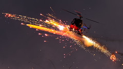 Otto the helicopter during his fireworks show at the Sanicole Sunset Airshow 2019 (PH-OTO) Tags: sanicole sunset airshow 2019 hechtelt kleine brogel air aircraft airline airlines airplane airport avgeek civil military private general aviation aviationdaily aviationgeek avporn canon eos fighter fighterjet flight fly force helicopter jet photo photography photos pilot plane planespotting sky spotting fireworks otto